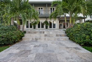 Silver Tumbled Pavers used at an entrance.